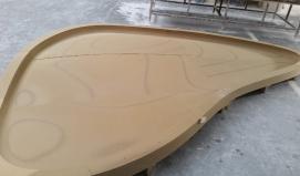 Fabrication de coques en staff courbe et irrégulière